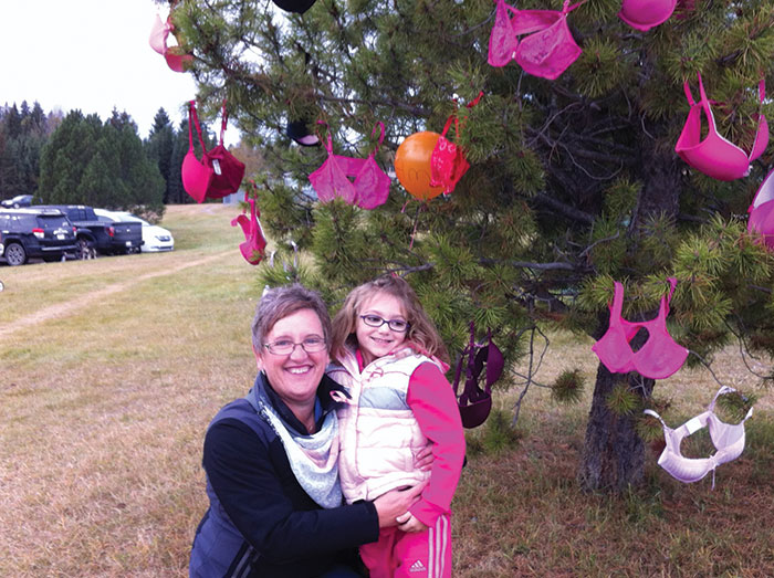 Jodi Mantey poses with her granddaughter, Kallie, at the 2013 Walk for the Cure in Edson