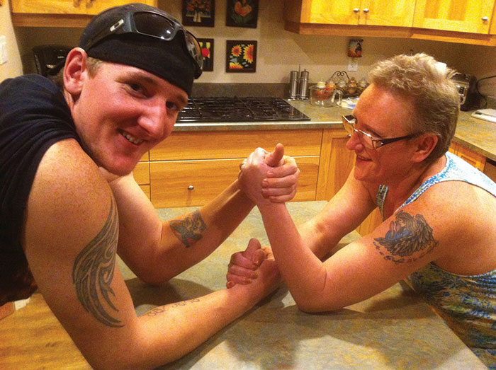 Jodi pits her muscle against her son, Trevor, in an arm wrestle