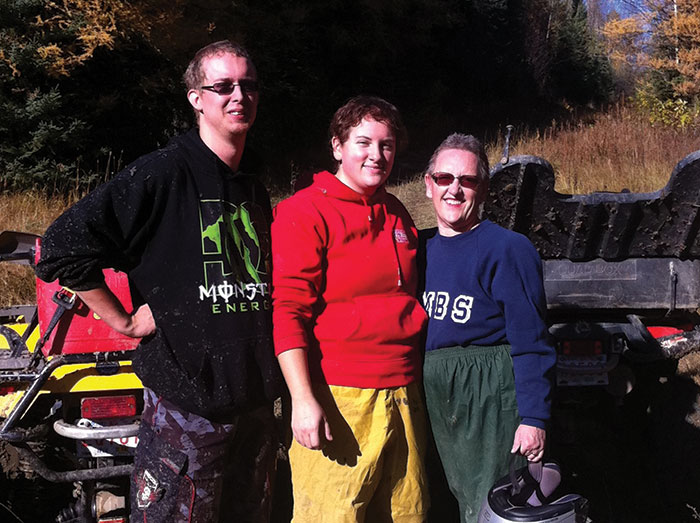 Jodi takes a break from a quad ride with her daughter Krystal and Krystal's fiance, Jason
